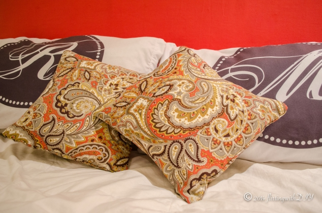 Paisley accent pillow bedroom coral